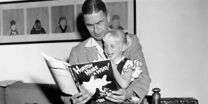 """Author and illustrator Theodor Seuss Geisel, known as Dr. Seuss, reads from his book """"Horton Hears a Who!"""" to four-year-old Lucinda Bell at his home in La Jolla, Ca., June 20, 1956. (AP Photo)"""